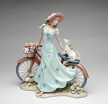 Porcelain Lady with Bicycle Figurine