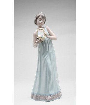 Girl Holding Basket of Flowers Porcelain Figurine